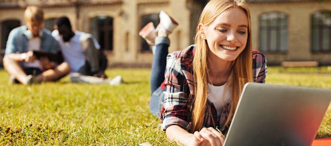 College girl behind laptop